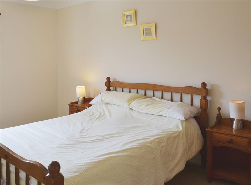 Double bedroom at Cockleshell Cottage in Sea Palling, Norfolk