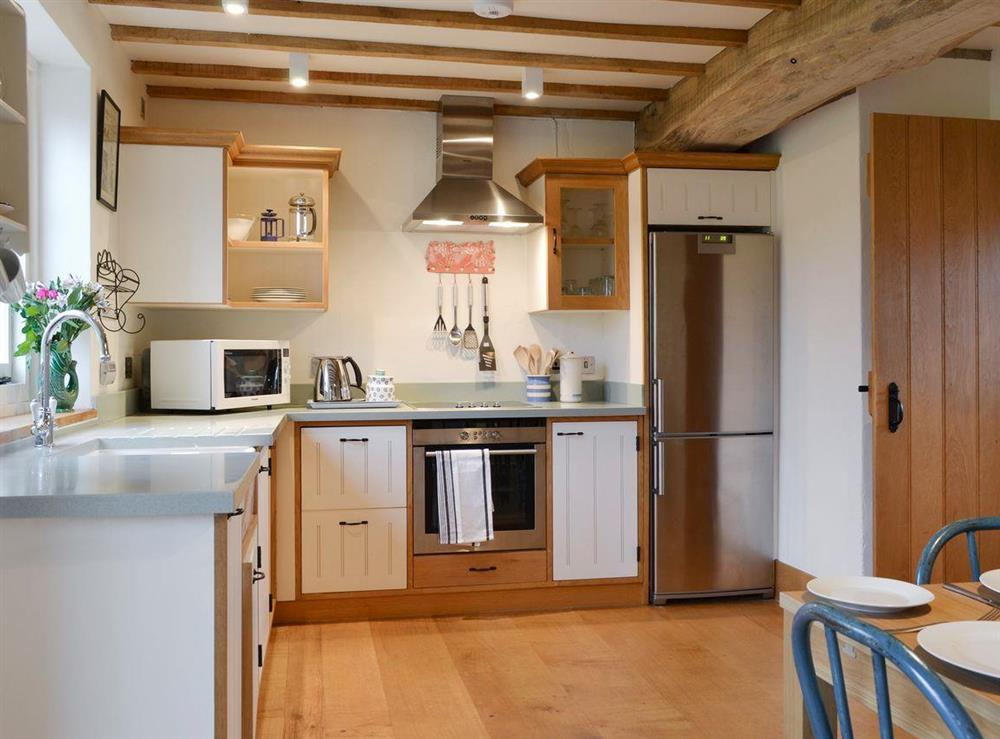 Spacious kitchen with dining area at Field House,
