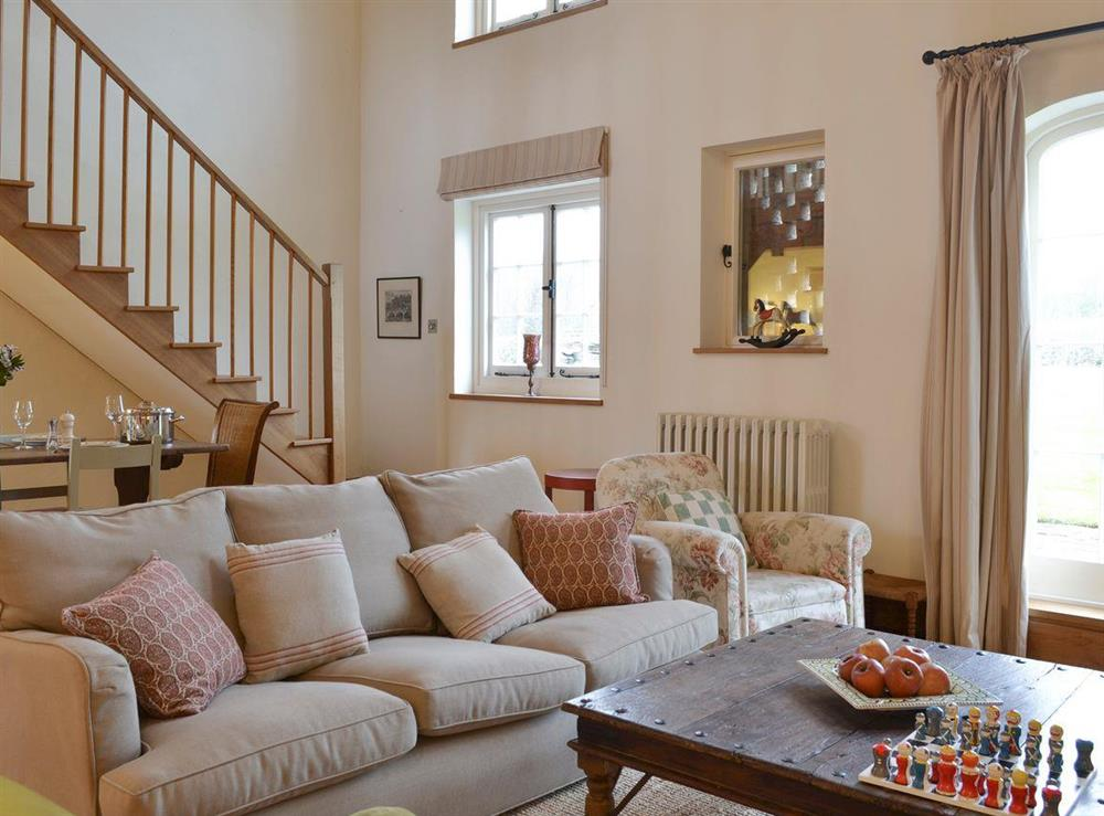 Comfy seating within living and dining room at The Dairy,