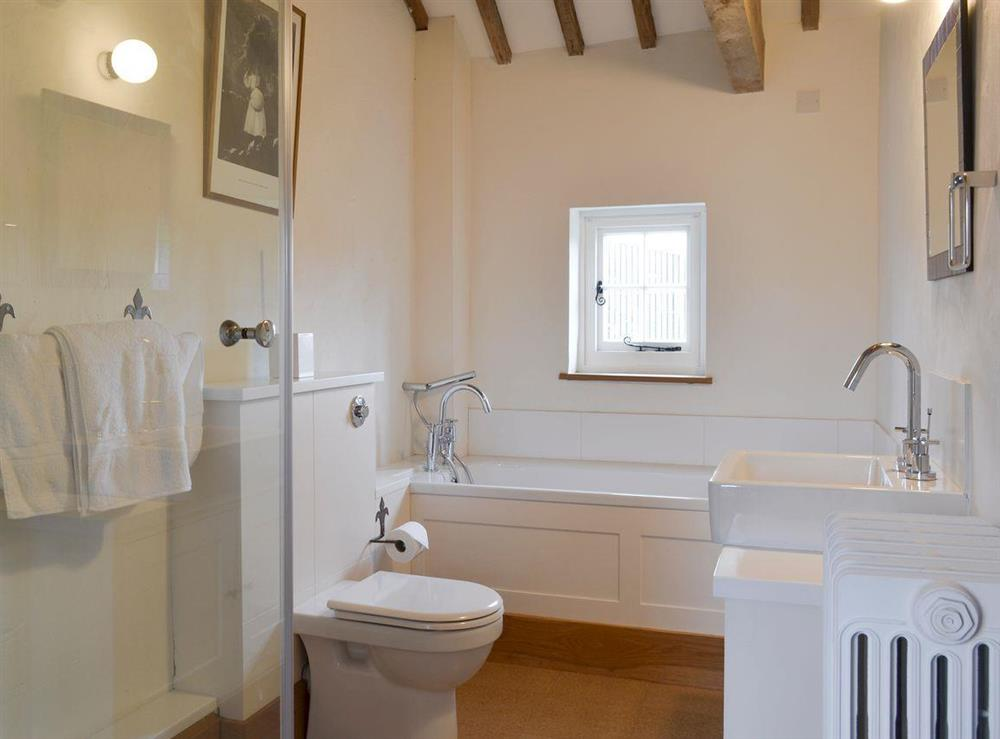 Family bathroom with separate shower cubicle at The Dairy,