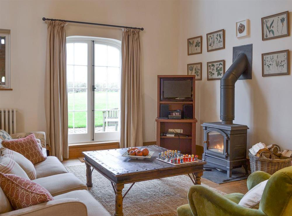 Warm and welcoming living area with wood burner at The Dairy,