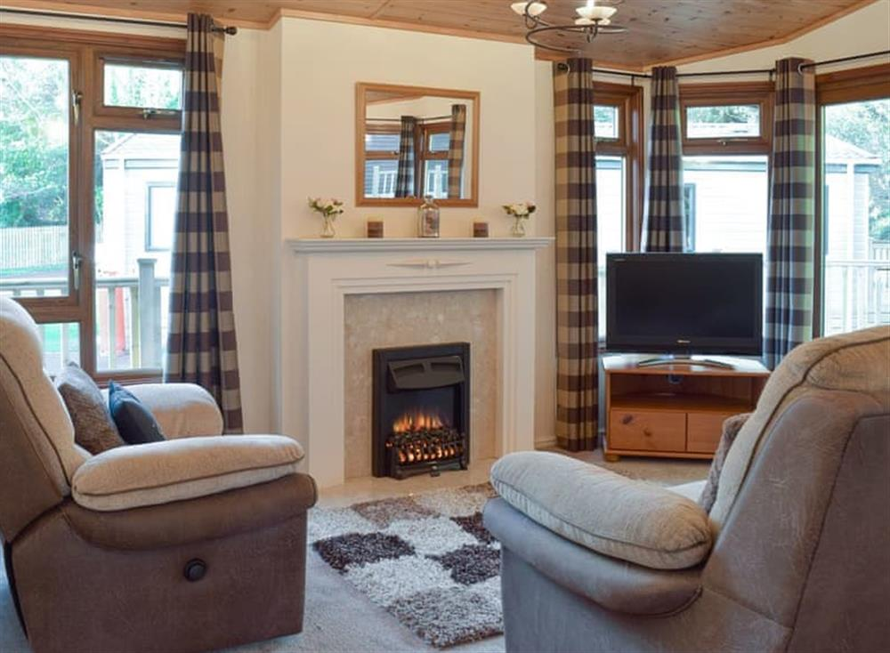 Welcoming living area at Colman Brook Lodge in Corton, near Lowestoft, Suffolk
