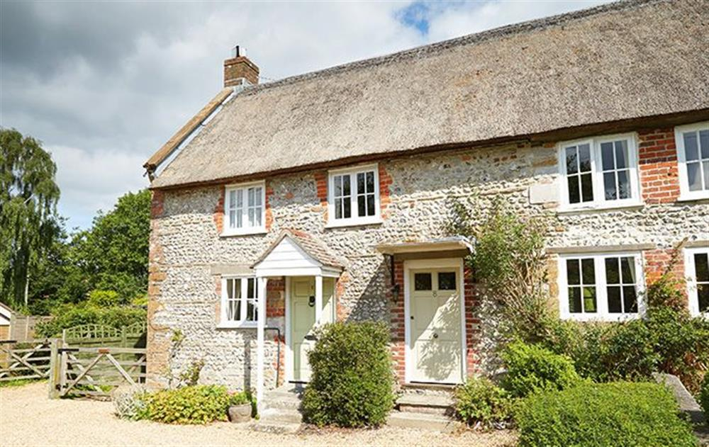 Coombe cottage is to the left of the door with the porch at Coombe Cottage, Sydling St Nicholas