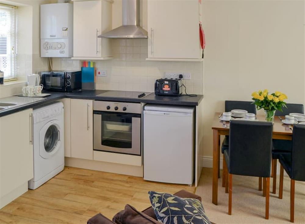 Well equipped kitchen area at Coots Nest in Stalham Staithe, near Norwich, Derbyshire