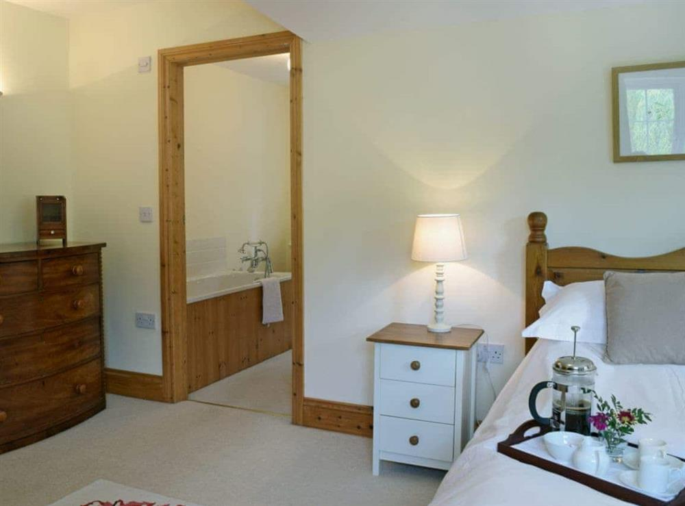 Charming double bedroom with kingsize bed and en-suite (photo 2) at Cornant in Llechryd, near Cardigan, Dyfed