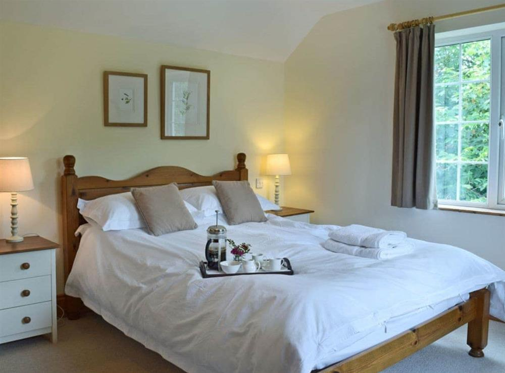 Charming double bedroom with kingsize bed and en-suite at Cornant in Llechryd, near Cardigan, Dyfed