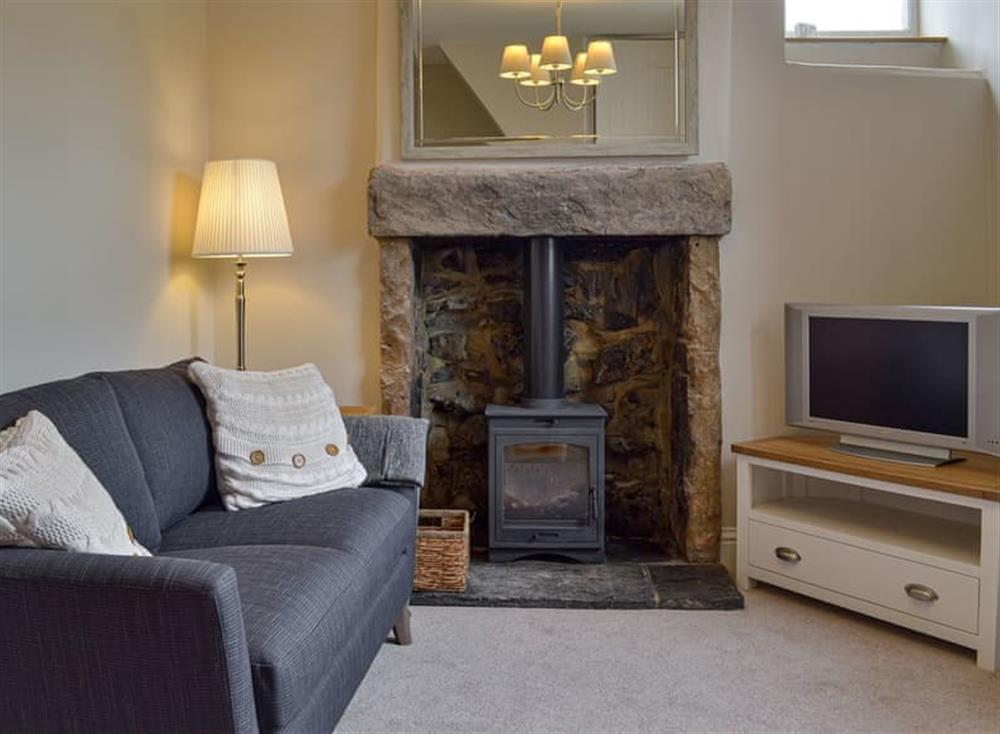 Cosy living room with wood burner at Corner Cottage in Great Longstone, near Bakewell, Derbyshire