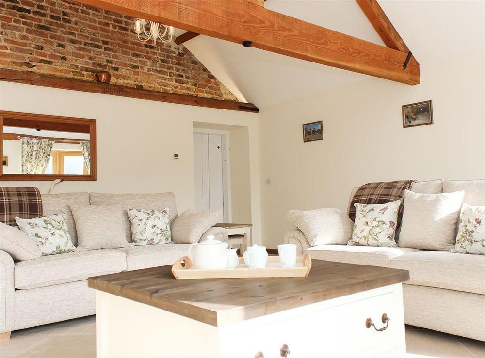 Beautifully presented living room with beams at The Old Barn,