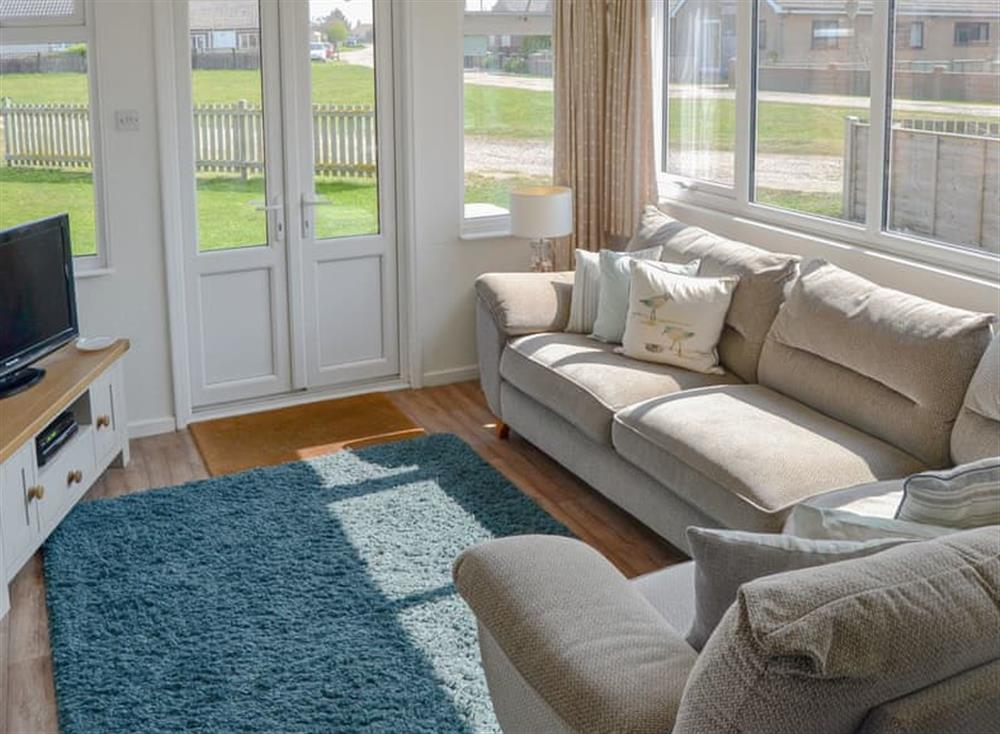 Light and airy living area at Cottage By The Sea in Bacton, near North Walsham, Norfolk