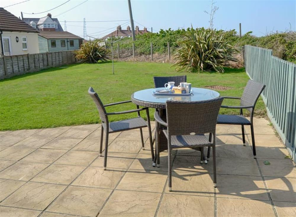 Patio area at Cottage By The Sea in Bacton, near North Walsham, Norfolk