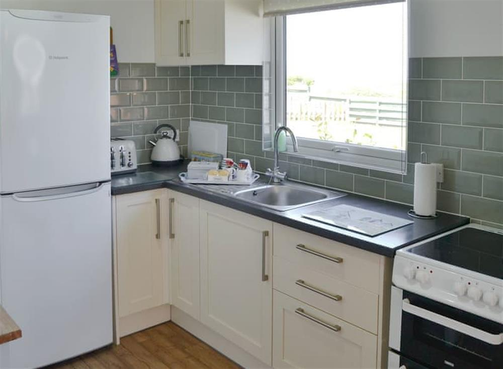 Well equipped kitchen at Cottage By The Sea in Bacton, near North Walsham, Norfolk