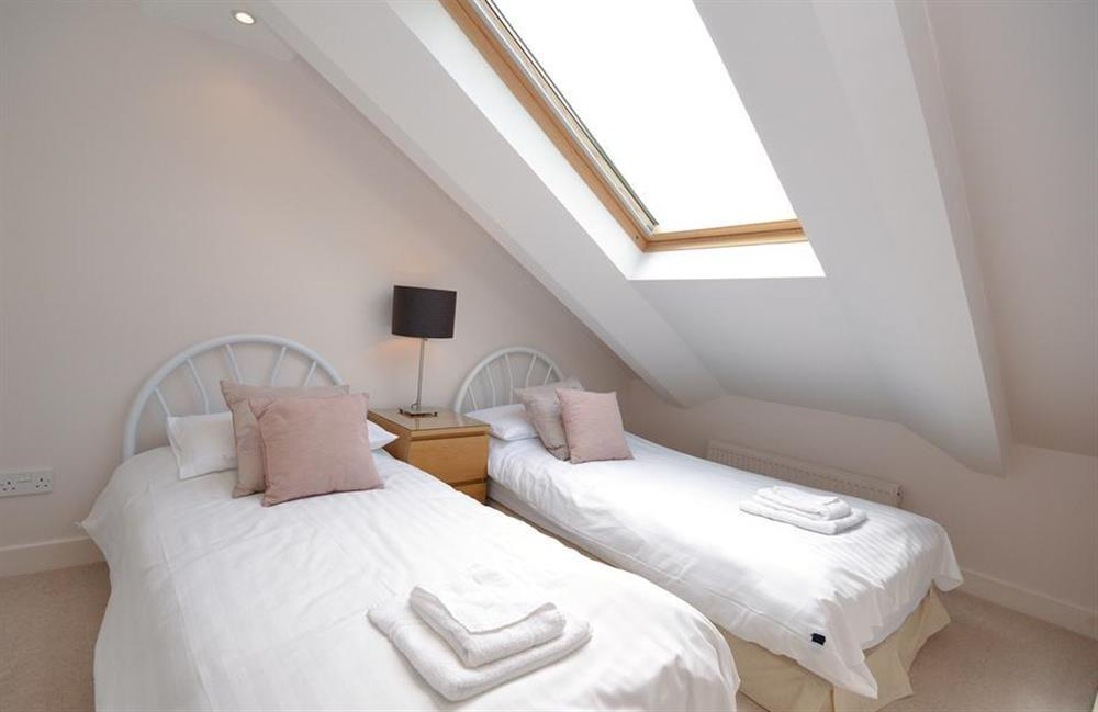 Small twin bedroom with sloped eaves, better suited for children or a single adult at Cotterbury, Dartmouth