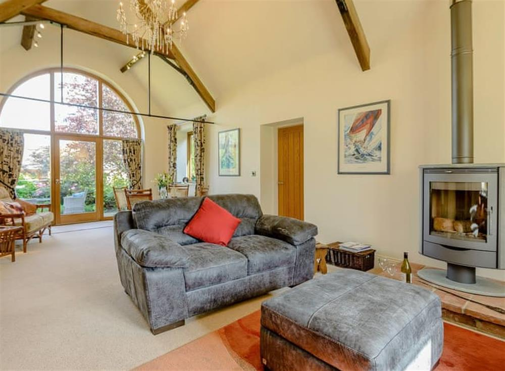 Luxurious living room with wood burner at Courtyard Lodge in Rufford, near Newark, Nottinghamshire
