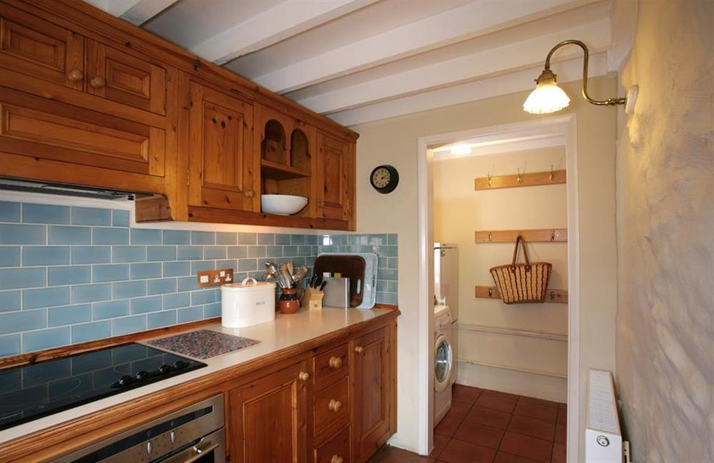 Another view of the kitchen which leads into a utilty alcove at Crab Cottage, Stoke Gabriel