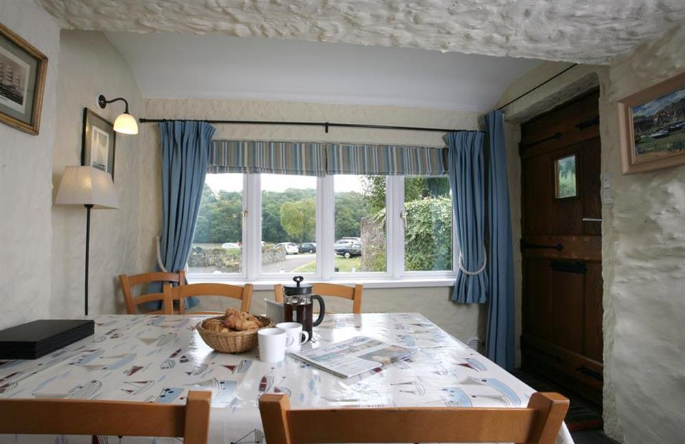 The dining area with views of The Mill Pool at Crab Cottage, Stoke Gabriel
