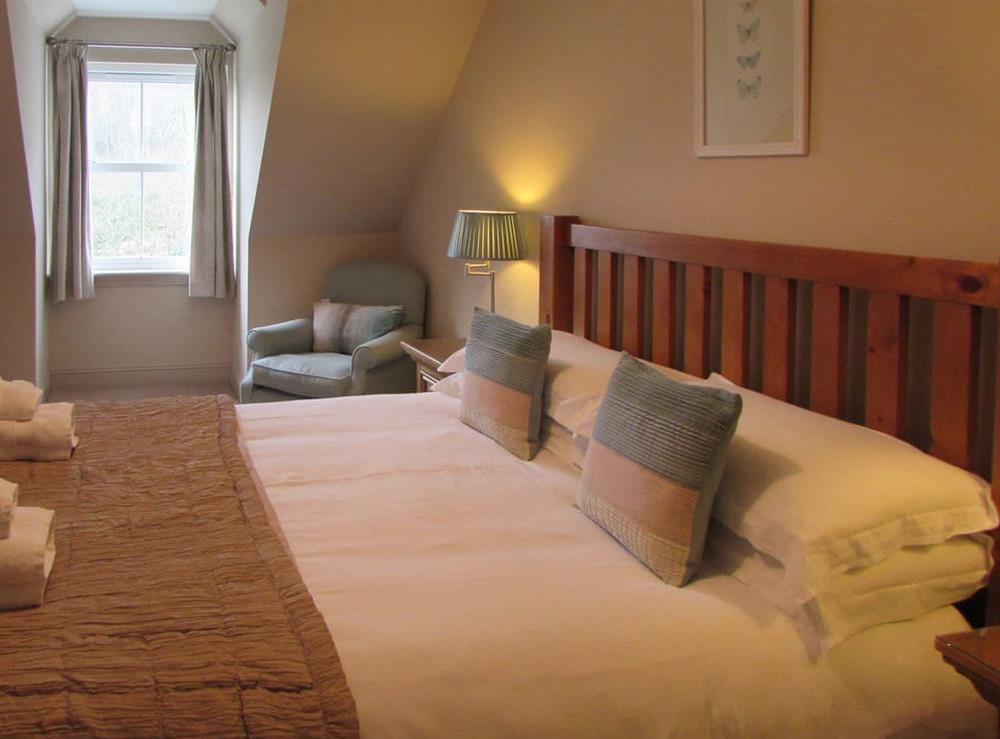 Double bedroom at Pipers Cottage,