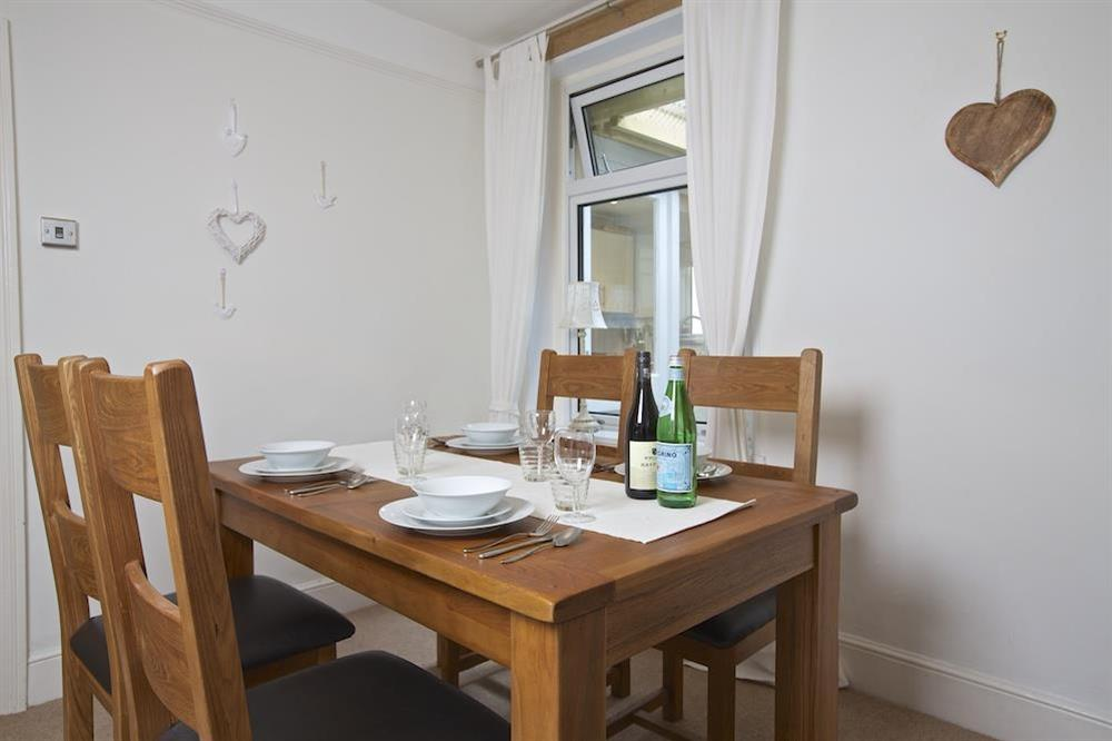 A lovely oak dining table and chairs are a great feature in the dining room at Crew House in Dart Marina, Dartmouth