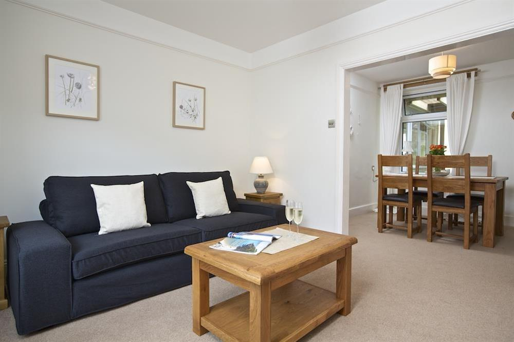 A well presented light and airy room which leads straight on to the dining room at Crew House in Dart Marina, Dartmouth