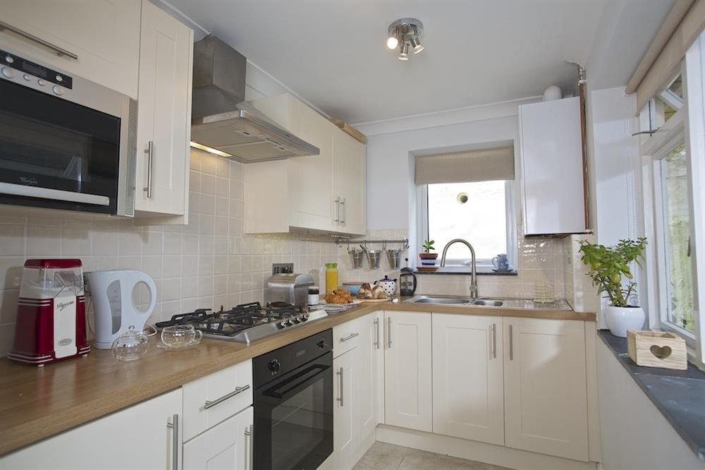 Bright and modern kitchen with door that leads out to the rear courtyard area at Crew House in Dart Marina, Dartmouth