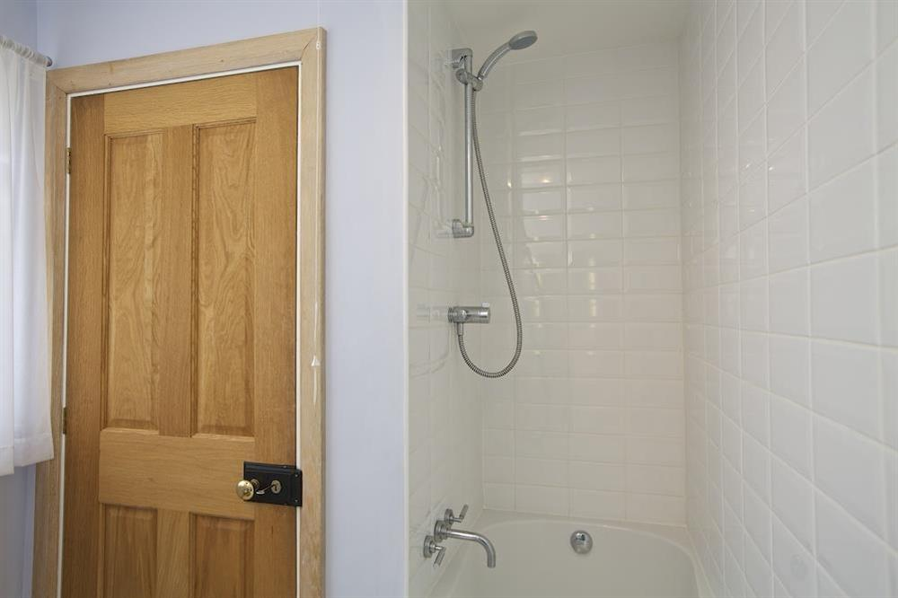 Bright bathroom with bath and shower (over) (photo 2) at Crew House in Dart Marina, Dartmouth