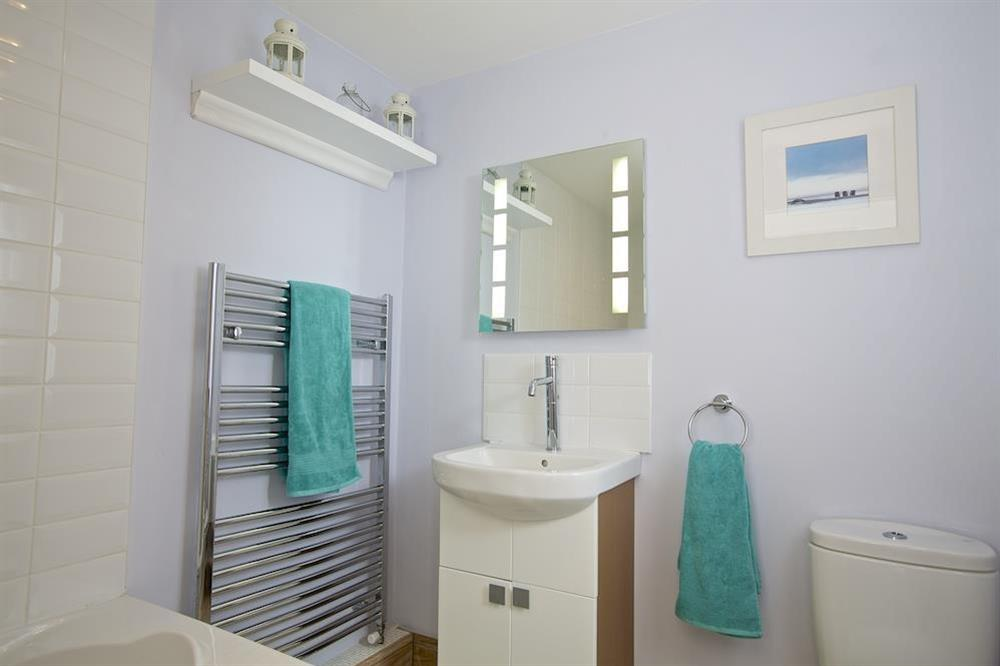 Bright bathroom with bath and shower (over) at Crew House in Dart Marina, Dartmouth