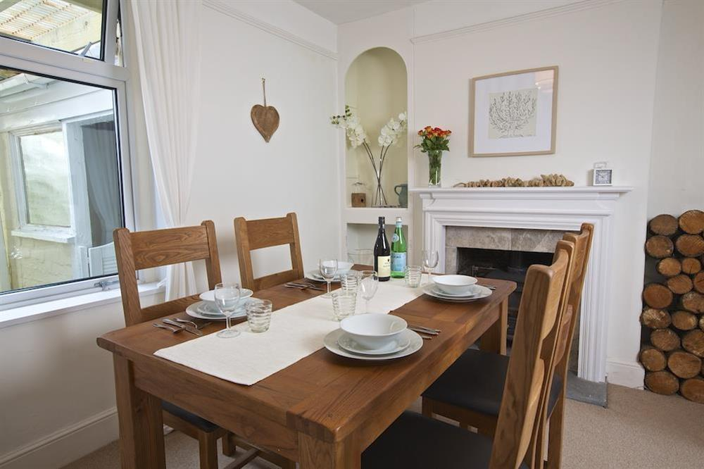 Dining room with seating for four at Crew House in Dart Marina, Dartmouth