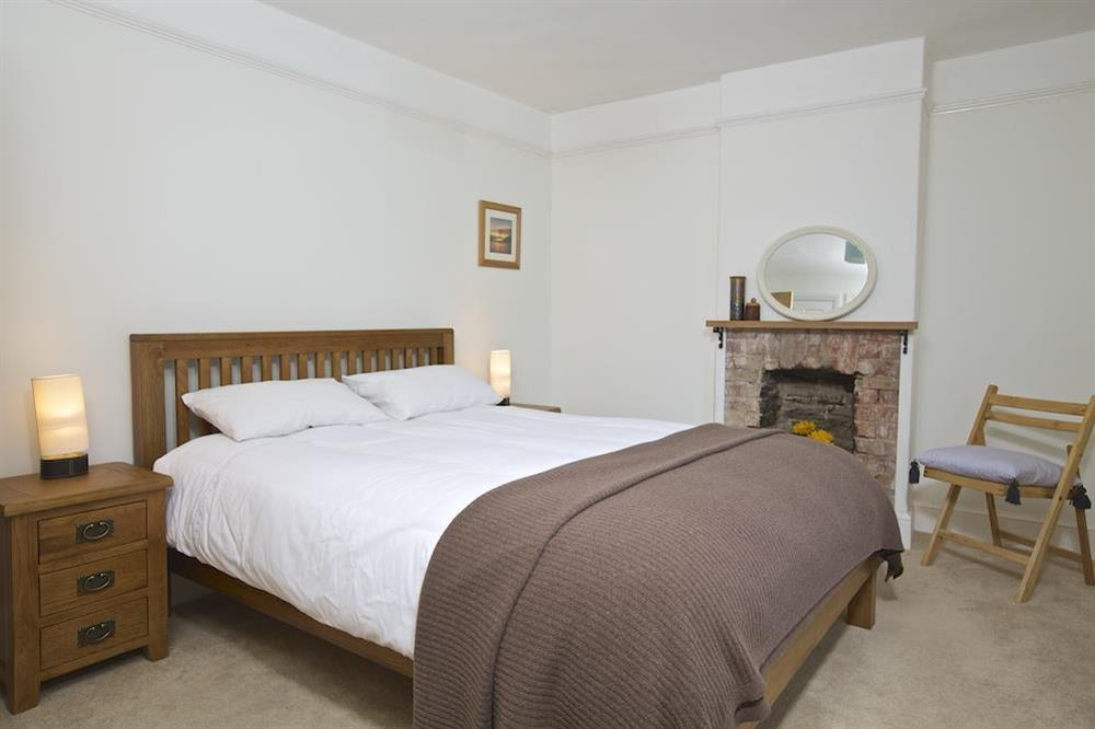 Master bedroom with King-size bed at Crew House in Dart Marina, Dartmouth