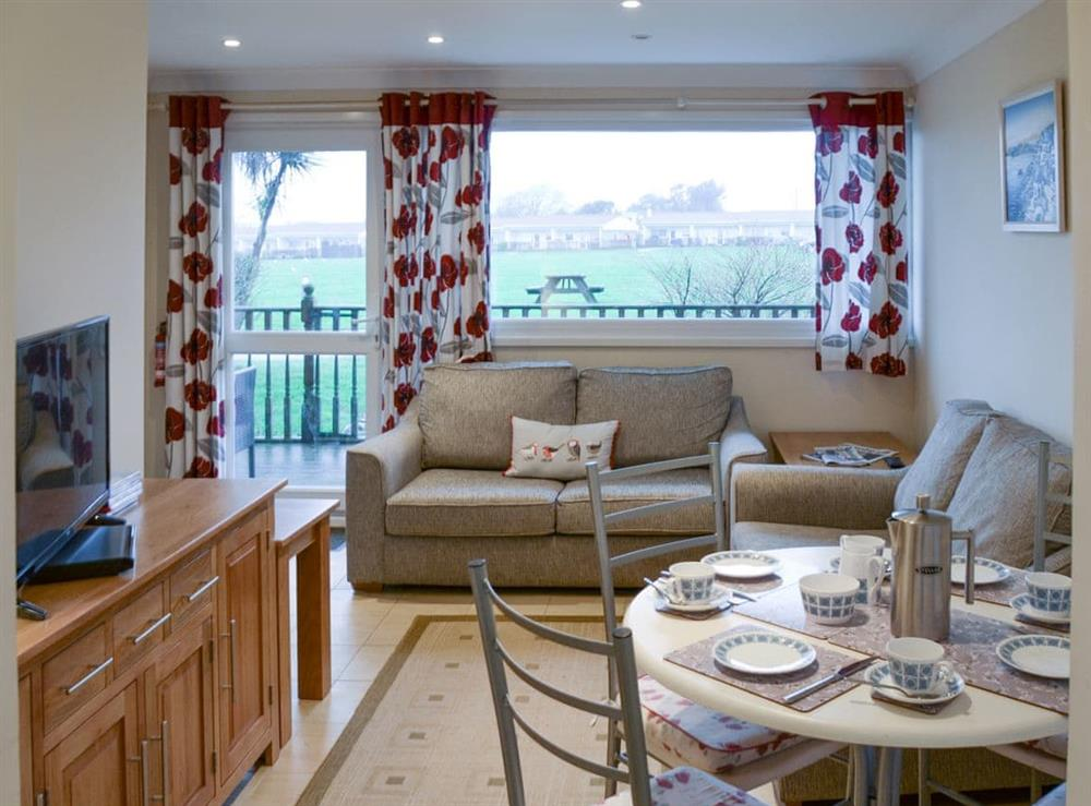 Living room/dining room at Crock of Gold in Bacton, Norfolk
