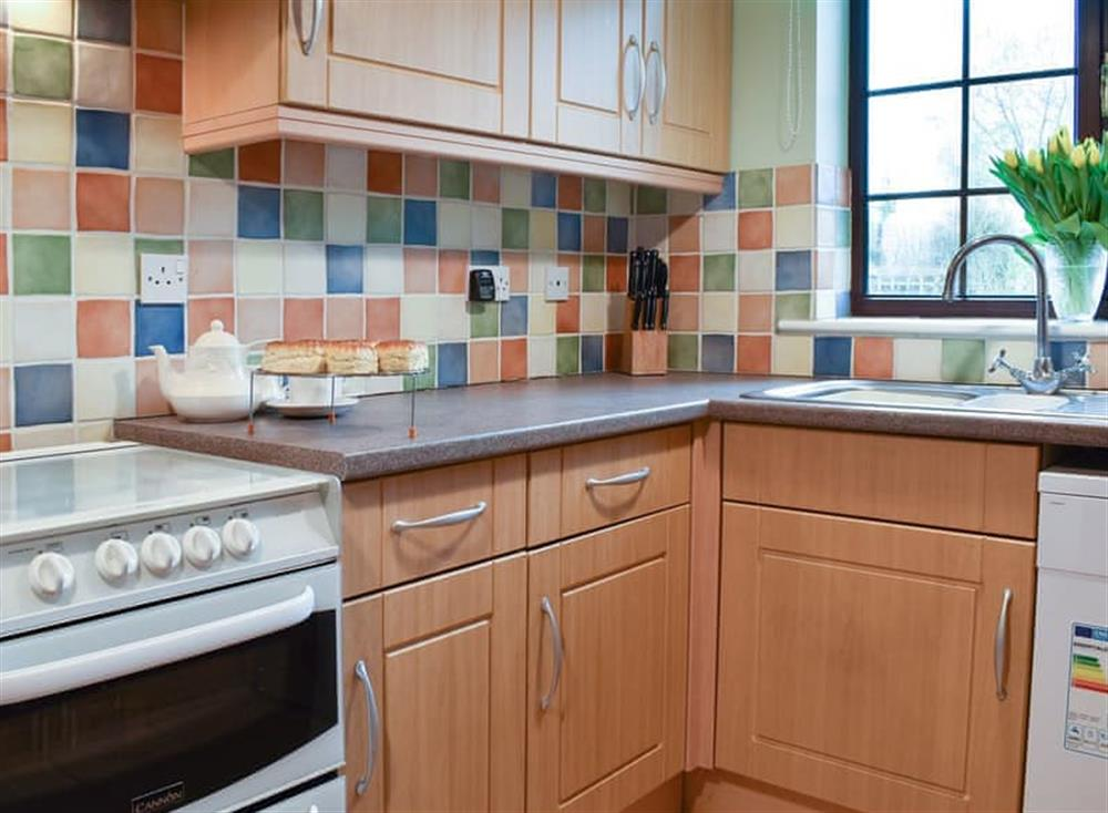 Beautifuuly tiled kitchen at Croft Cottage in Lydlinch, near Sturminster Newton, Dorset