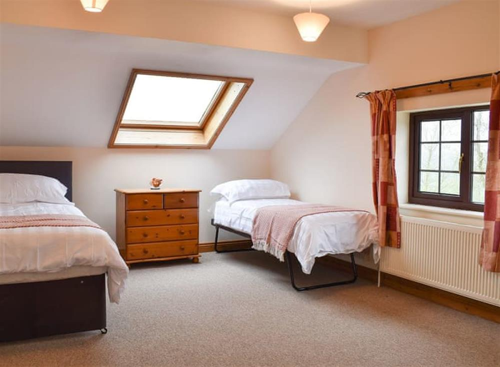 Bedroom with single and pull-out beds at Croft Cottage in Lydlinch, near Sturminster Newton, Dorset