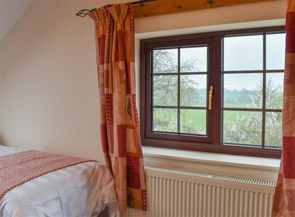 Bedroom with wonderful view over the surrounding countryside at Croft Cottage in Lydlinch, near Sturminster Newton, Dorset