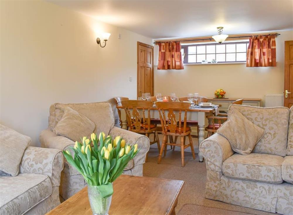 Comfortable living and dining room at Croft Cottage in Lydlinch, near Sturminster Newton, Dorset