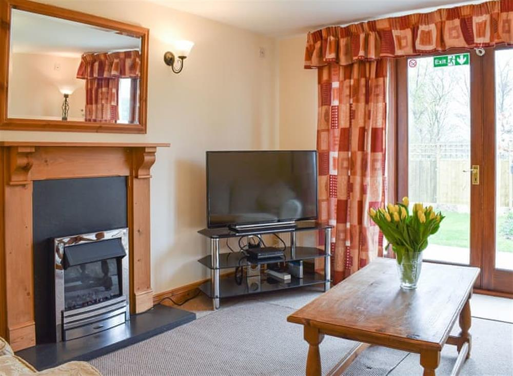 Delightful living area with doors to the patio and garden at Croft Cottage in Lydlinch, near Sturminster Newton, Dorset