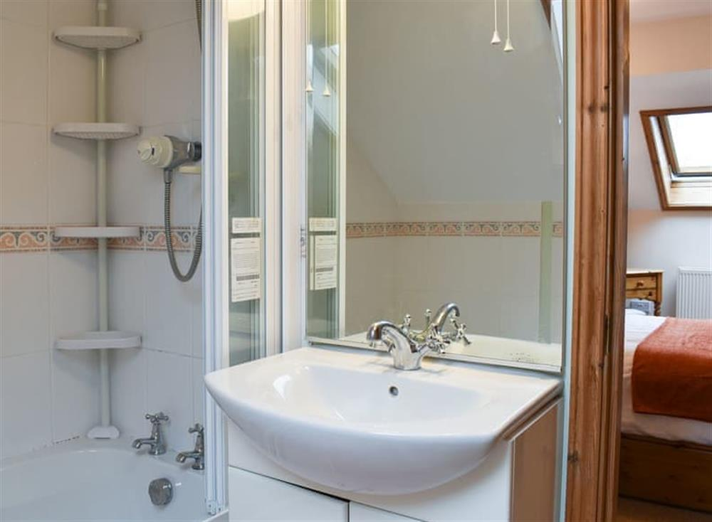 En-suite bathroom with shower over the bath at Croft Cottage in Lydlinch, near Sturminster Newton, Dorset