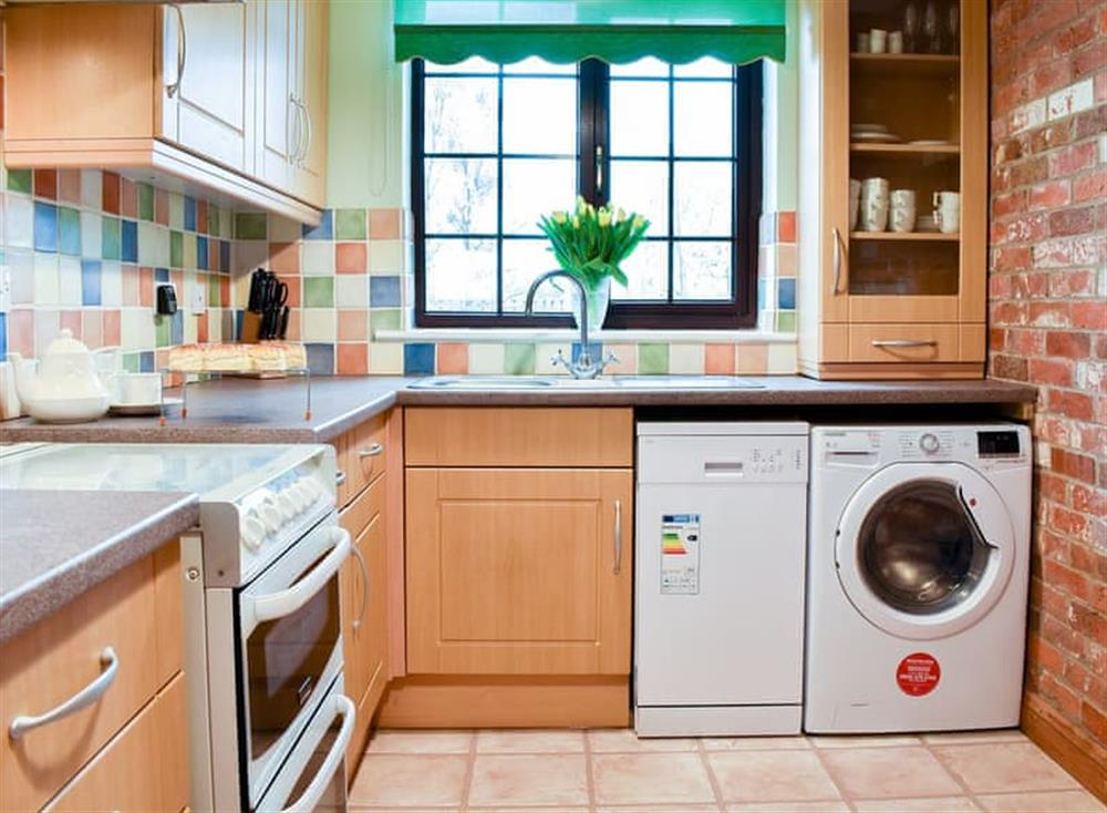 Kitchen with laundry facilities at Croft Cottage in Lydlinch, near Sturminster Newton, Dorset