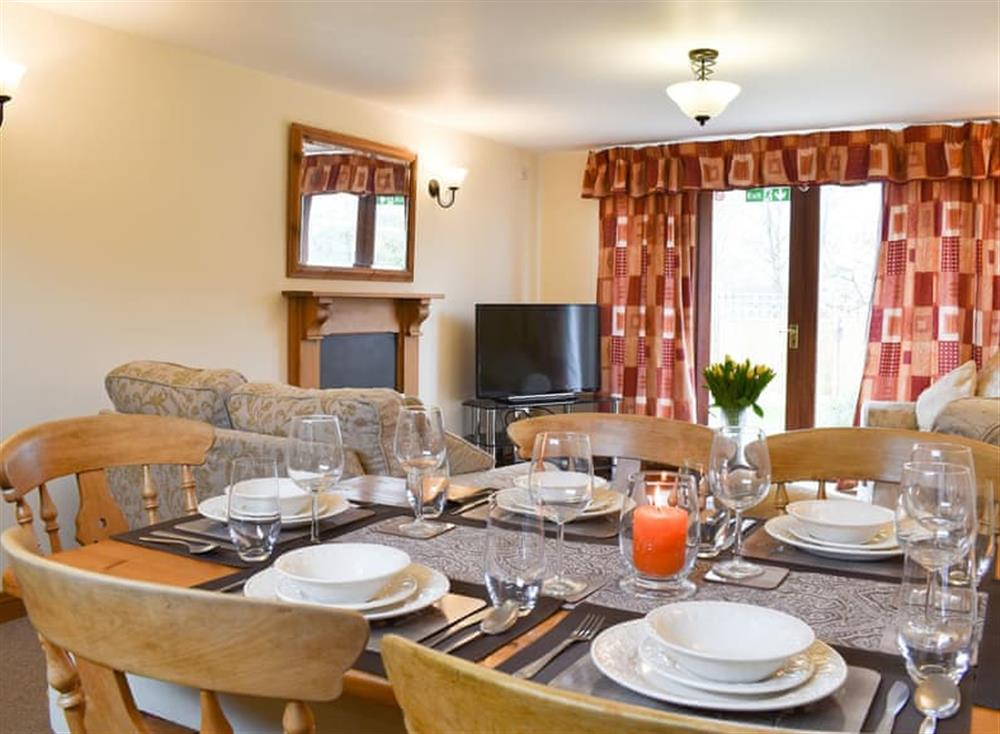 Traditional dining area and lovely cosy living room at Croft Cottage in Lydlinch, near Sturminster Newton, Dorset