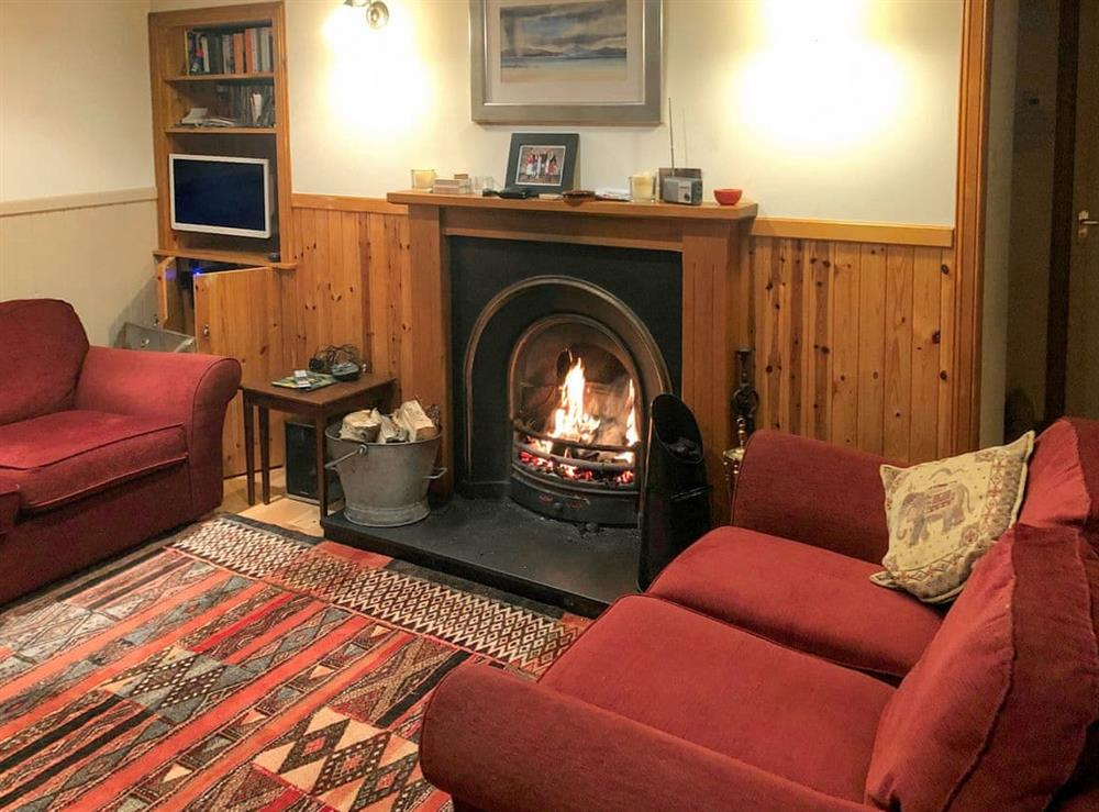 Cosy living room with an open fire at Crofts in Glenbuchat, Aberdeenshire