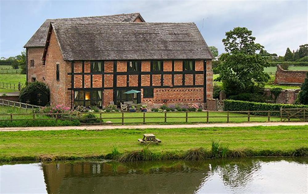 Cromwells Manor with small fishing lake  at Cromwells Manor, near Nantwich