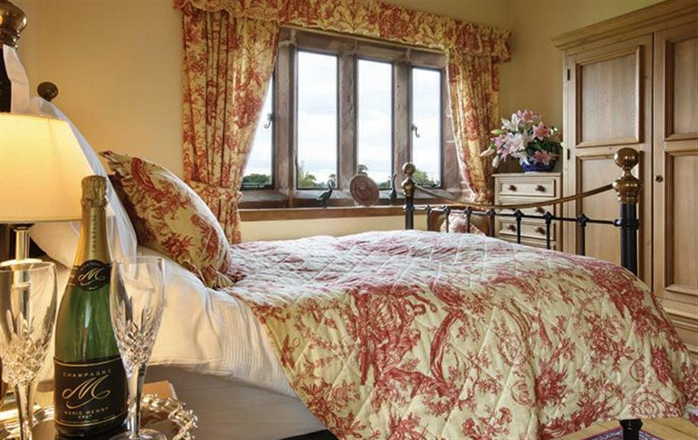 First floor:  Double bedroom with a 5' bed and en-suite bathroom with shower over bath and wc at Cromwells Manor, near Nantwich