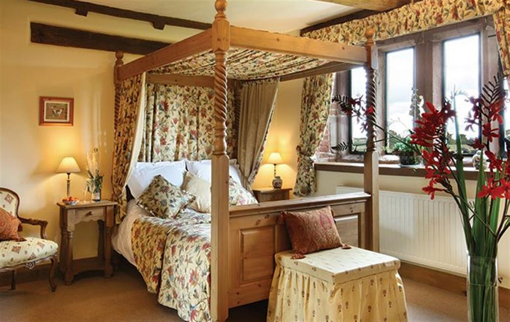 Ground floor:  Double bedroom with a 5' four-poster bed and en-suite bathroom at Cromwells Manor, near Nantwich