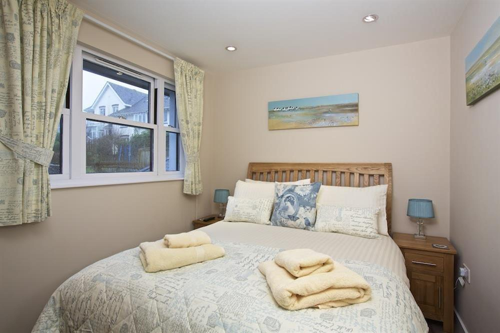 Double bedroom with wooden framed bed at Crowthers in , Dartmouth