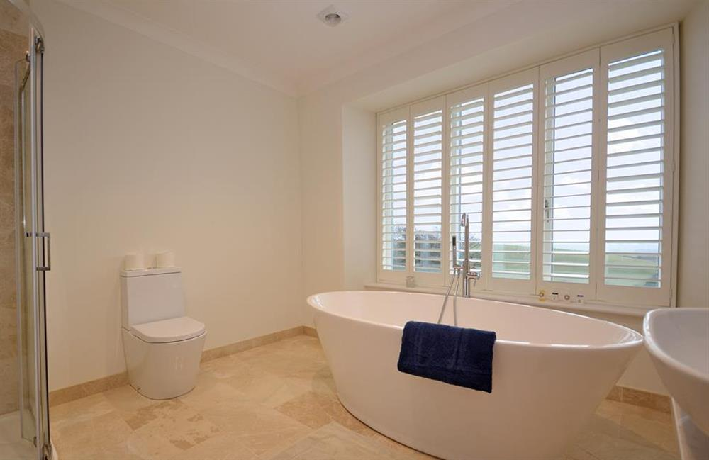 The family bathroom with roll top bath and separate shower cubicle at Cuttery House, East Allington