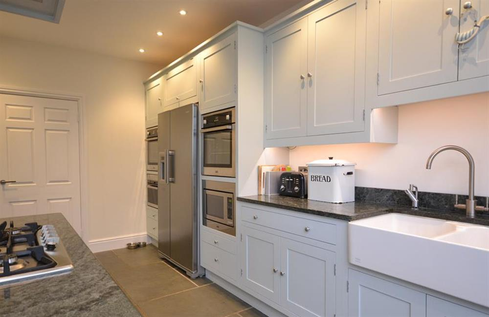 The kitchen with two double ovens, steam oven and island unit with breakfast bar at Cuttery House, East Allington