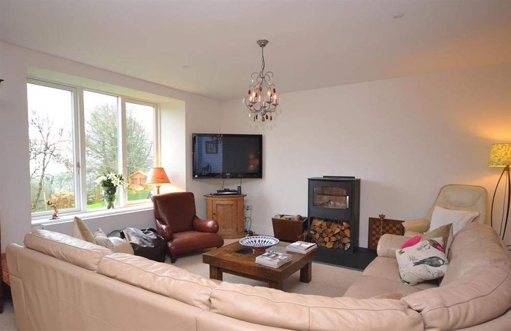 """The seating area with 50"""" TV and wood burner at Cuttery House, East Allington"""