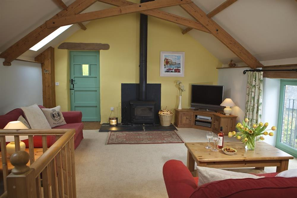 First floor lounge with wood burning stove at Daisy in Blackawton, Dartmouth
