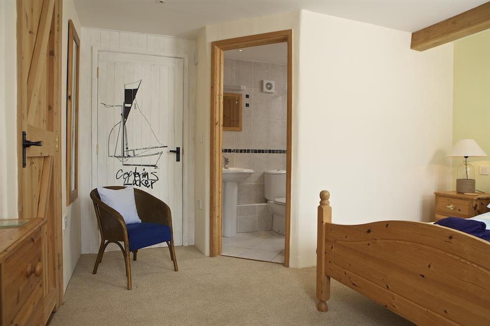 Master bedroom with en suite shower room at Daisy in Blackawton, Dartmouth