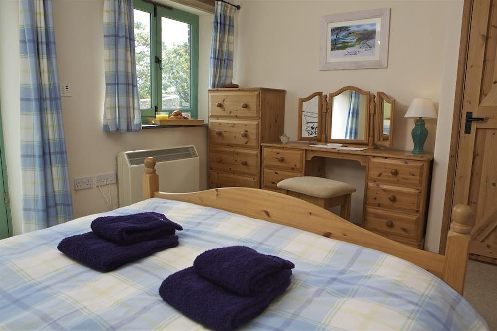 Master bedroom with King-size bed and en suite shower room at Daisy in Blackawton, Dartmouth