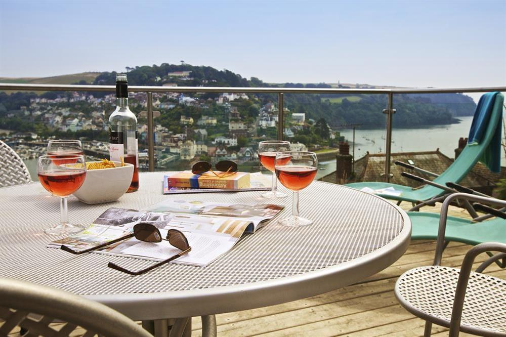 Enjoy a drink on the top deck of the tiered garden and take in the glorious river views at Dart Views in 98 Above Town, Dartmouth