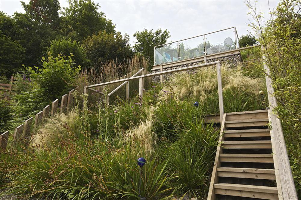 Wooden steps leading to upper decking area at Dart Views in 98 Above Town, Dartmouth