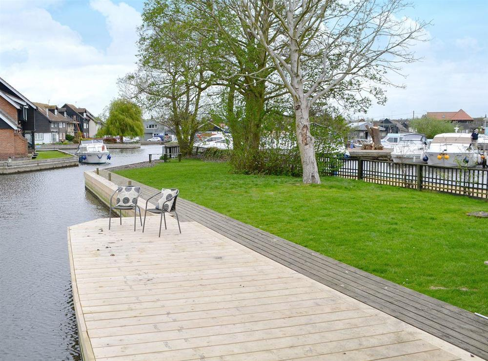 Private lawned garden by the waterside at Davids Island in Wroxham, Norfolk